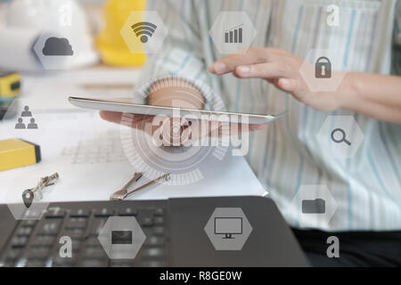 architect using tablet. engineer working on house blueprint of real estate project at workplace. construction & building concept - Stock Photo