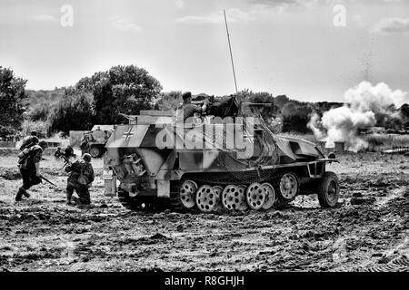 Panzer Unit engaging US Army Patrol at War and Peace Revival 2016 - Stock Photo
