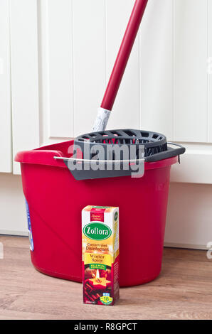Zoflora Concentrated Disinfectant & Plastic Mop and Bucket in a Home Environment, UK - Stock Photo