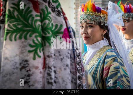 women in traditional dress, for folk dance, dancer, in Rukhobod Mausoleum, Samarkand, Uzbekistan - Stock Photo