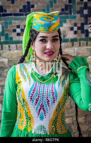 Woman in traditional costume, Samarkand, Uzbekistan - Stock Photo
