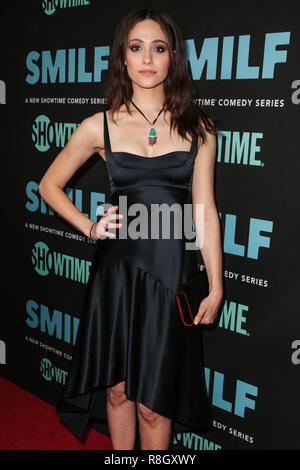 HOLLYWOOD, LOS ANGELES, CA, USA - OCTOBER 09: Actress Emmy Rossum wearing a Narciso Rodriguez dress and Sophia Webster shoes arrives at the Los Angeles Premiere Of Showtime's 'SMILF' held at the Harmony Gold Theater on October 9, 2017 in Hollywood, Los Angeles, California, United States. (Photo by Image Press Agency) - Stock Photo