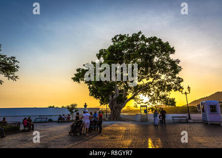 Panama City, Panama - Mar 10th 2018 - Tourists and locals enjoying a colorful sunset at the old colonial town, the Casco Viejo neighbourhood in Panama - Stock Photo