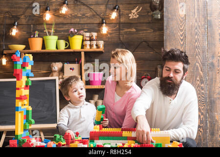 Daycare concept. Little child play daycare game with mother and father. Daycare preschool. Family daycare - Stock Photo
