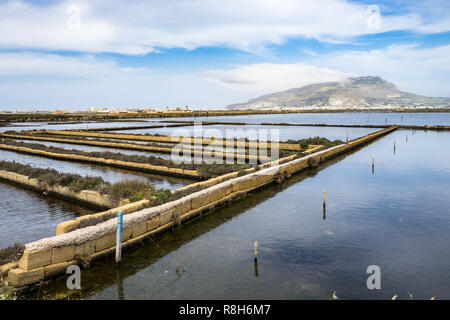 Landscape of Saline di Trapani e Paceco nature reserve with Mount Erice on the background, Sicily, Italy - Stock Photo
