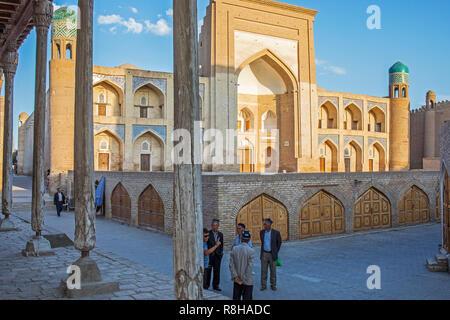 Street scene in Ichon-Qala, old city, in background Qutlug Murod Inoq madrasa, Khiva, Uzbekistan - Stock Photo