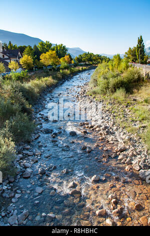 An early morning shot of the Gallego river as it flows through the village of Biescas in the Spanish Pyrenees. - Stock Photo