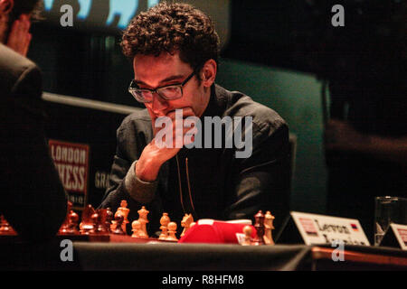 London, UK. 15th December 2018. Chess grandmaster Fabiano Caruana, (US) world #2   playing for the Third and Fourth place in the final of the Chess Classics been held in London Olympia @Paul Quezada-Neiman/Alamy Live News - Stock Photo