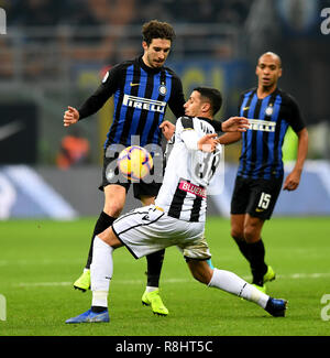 Milan, Italy. 15th Dec, 2018. Inter Milan's Sime Vrsaljko (L) vies with Udinese's Rolando Mandragora during the Serie A soccer match between Inter Milan and Udinese in Milan, Italy, Dec. 15, 2018. Inter Milan won 1-0. Credit: Augusto Casasoli/Xinhua/Alamy Live News - Stock Photo