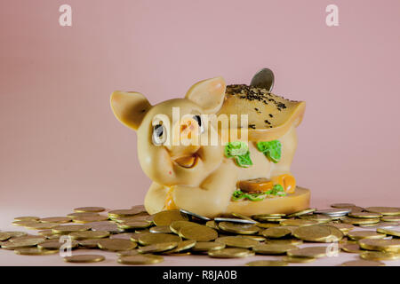 piggy bank with coin on pink background - Stock Photo