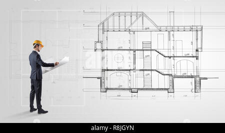Architect watching a 2 dimension house plan  - Stock Photo
