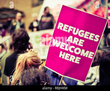 Busy Street Protest March With A Sign Saying Refugees Are Welcome Heren - Stock Photo