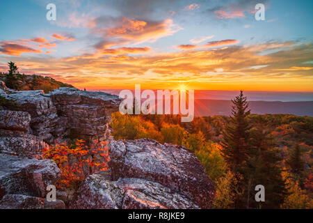 The sun rises over a mountain ridge in the Highlands of West Virginia. - Stock Photo