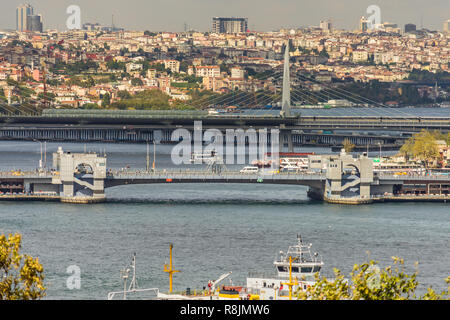 View over the Golden Horn with the Galata Bridge and the Atatürk Bridge in Istanbul - Stock Photo