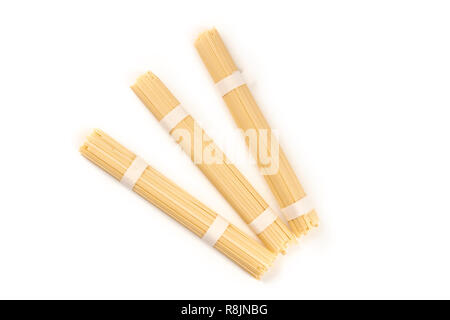 A photo of three individually wrapped portions of udon noodles, shot from the top on a white background with a place for text - Stock Photo