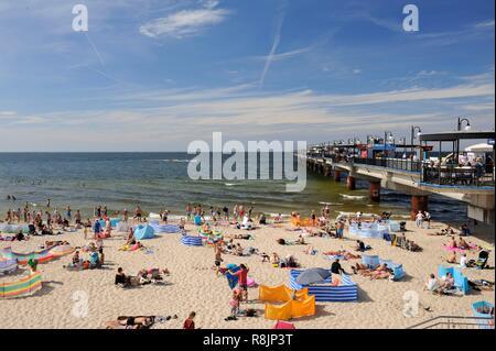 Poland, West Pomeranian, Miedzyzdroje, beach and pier or Molo by the Baltic Sea - Stock Photo
