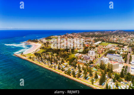 Waterfront of Port Macquarie town on Australian Middle north coast of Pacific ocean along Hastings river on a sunny summer day in aerial view. - Stock Photo