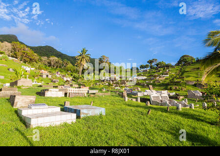 Ovalau, Fiji. Hillside cemetery with summer lush green lawns, palms, blue sky and old gravestones, Ovalau island, Lomaiviti archipelago, Fiji, Melanesia, Oceania, South Pacific Ocean. - Stock Photo