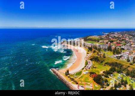 Port Macquarie on Australian NSW pacific coast seen from above around river delta and local beach adjusted to caravan park for tourists. - Stock Photo