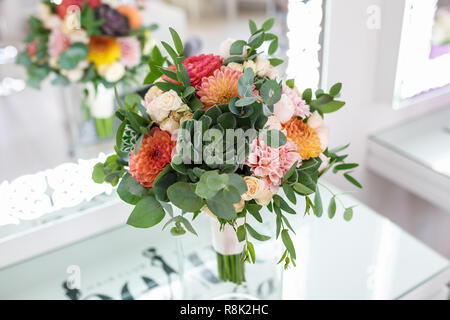 bright wedding bouquet of summer dahlias and roses - Stock Photo
