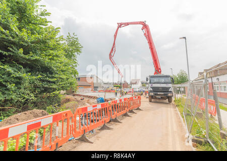 Pouring the concrete slab foundations at Maggies Life Centre Cardiff 13.06.2018. Please credit: Phillip Roberts - Stock Photo