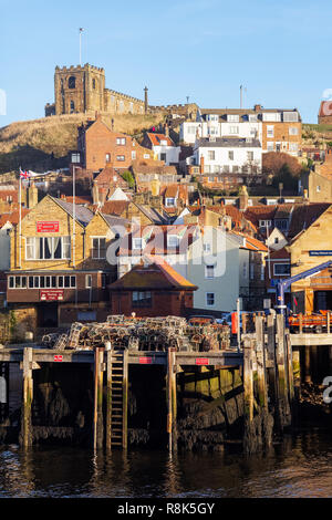 Winter sunlight on St Marys Church, the 'Old town quarter' and Fish pier, Whitby, North Yorkshire, UK - Stock Photo
