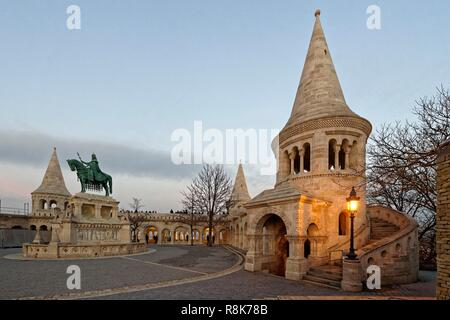Hungary, Budapest, listed as World Heritage by UNESCO, Buda district, Equestrian statue of King Stephen I of Hungary and Fisherman's Bastion (Halaszbastya), Neoromanesque style of the end of 19th century on Castle Hill - Stock Photo