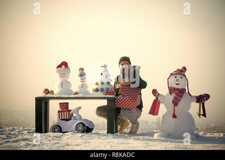Happy man opening gift box - Stock Photo