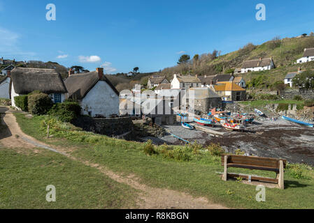Looking down into the little Cornish fishing cove of Cadgwith Cornwall UK Europe on a summer day . - Stock Photo