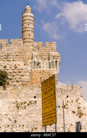 Street sign in front of the Tower of David and Old City walls in Jerusalem, Israel - Stock Photo