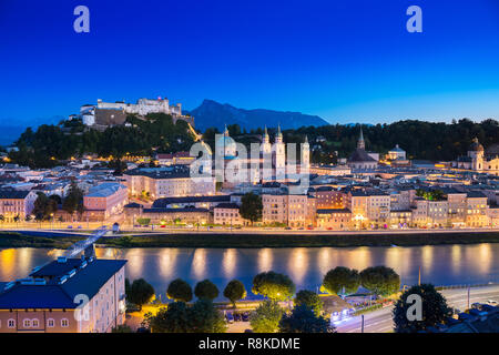 View of cityscape of Salzburg Cathedral, Fortress Hohensalzburg, and old castle in center of old town, where is the famous landmark for travel from to - Stock Photo