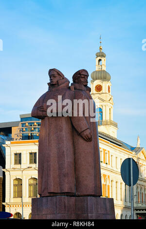 Communist statue of riflemen in Town Hall square in Riga in Latvia. - Stock Photo