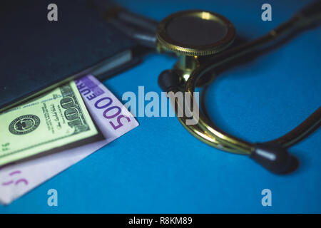 Dollars and euros from notepad and stethoscope on the table. The concept of bribes for doctors, bribing an auditor, corruption in medicine. - Stock Photo