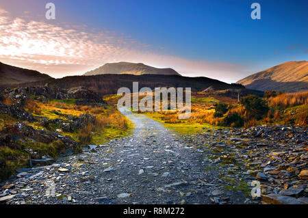 A winter view of a remote path in the rugged Snowdonia National Park, North Wales. - Stock Photo