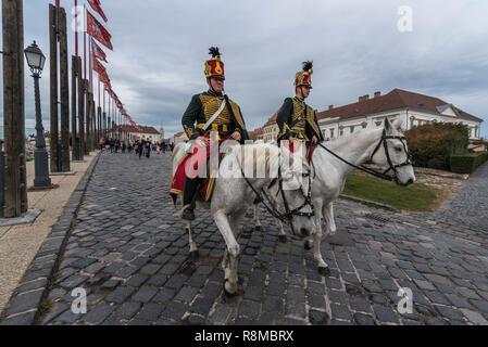 Hussars on horseback riding in Buda Castle, Budapest, Hungary - Stock Photo