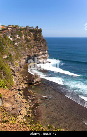 The cliffs and the ocean near the Uluwatu Temple on Bali, Indonesia. - Stock Photo