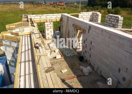 Laying reinforcement on the already erected wall 2018 - Stock Photo