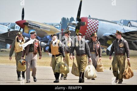 reenactors in U S A F world war 2  military uniform with  fighter aircraft behind - Stock Photo