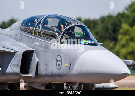 Pilots of a Swedish Air Force Saab JAS 39 Gripen jet plane at Royal International Air Tattoo, RIAT, RAF Fairford airshow. Taxiing in for show - Stock Photo