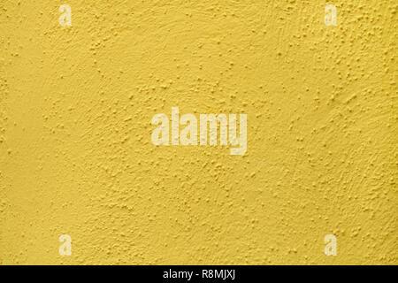 Yellow painted stucco wall on Burano Island in the Venetian Lagoon near Venice, Italy. Background texture. - Stock Photo