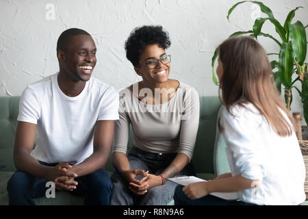 Happy African American couple at successful visit psychologist - Stock Photo