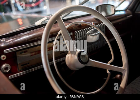 Dashboard with steering wheel of a classic car from the 1970's - Stock Photo