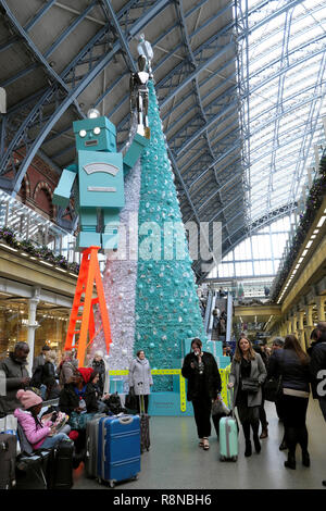 Tiffany & Co Christmas tree and robot and people in the shopping mall area at St Pancras International Railway Station in London UK  KATHY DEWITT - Stock Photo