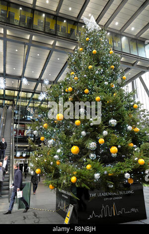 Vertical view of large Christmas tree with bauble decorations outside the Leadenhall office building in the City of London UK  KATHY DEWITT - Stock Photo