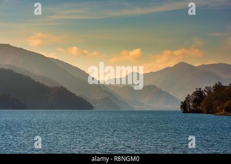 beautiful landscape with lake Chuzenji (Chuzenjiko) near Nikko in Japan, travel background - Stock Photo