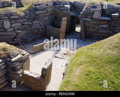 Skara Brae ancient village located on the Orkney Islands. On the way from Kirkwall we stopped at the standing stone called Ring of Brodgar. - Stock Photo