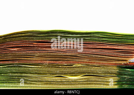 Pile of paper money isolated on white. - Stock Photo