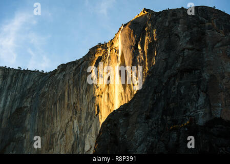 Horsetail Fall in Yosemite National Park at sunset in February. A rare opportunity to get sunshine and meltwater to combine and make this spectular li - Stock Photo