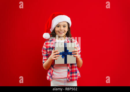 Christmas shopping. New year party. Santa claus kid. Happy winter holidays. Small girl. Present for Xmas. Childhood. Little girl child in santa red hat. Taking advantages of Christmas sales. - Stock Photo
