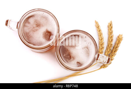 glass of foamy beer with wheat isolated on white background. Top view - Stock Photo